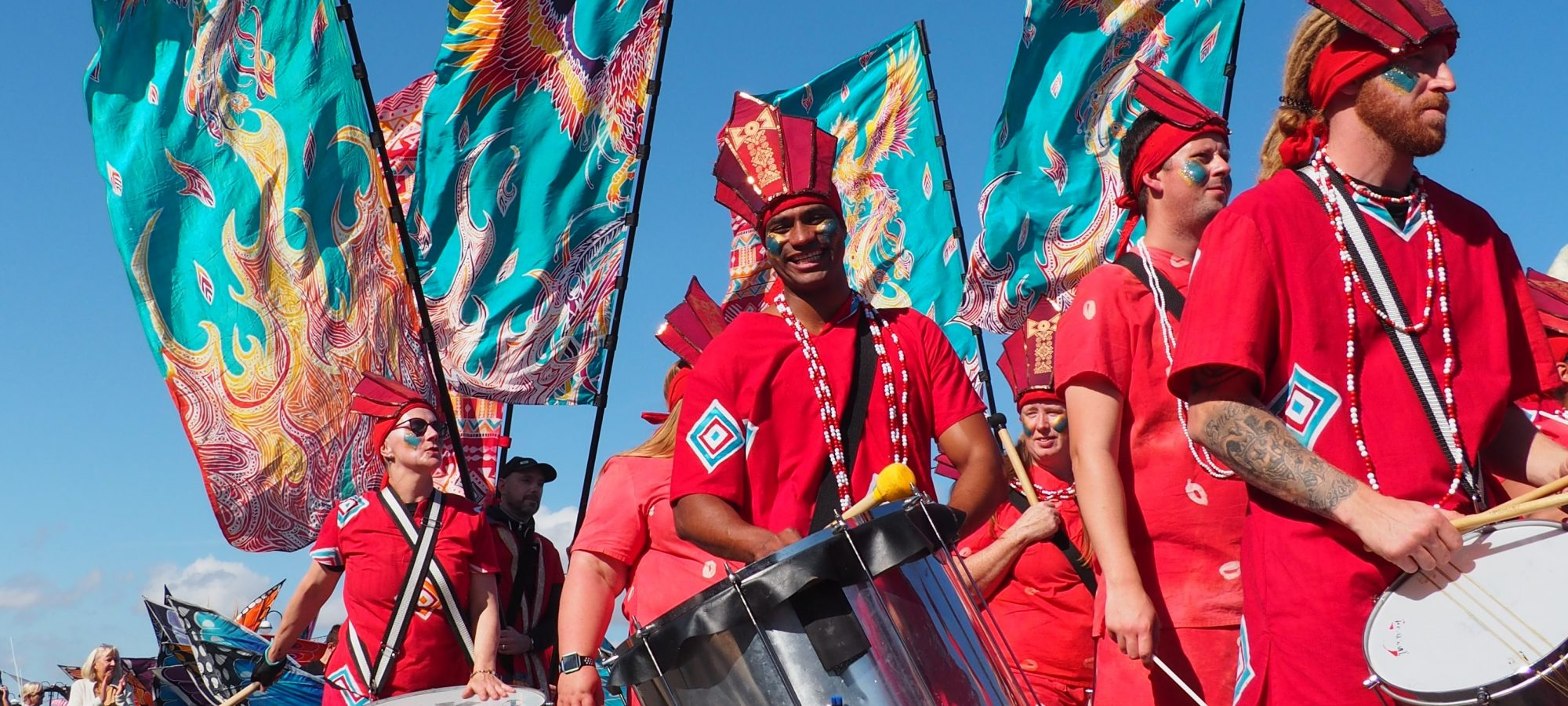 drummers in a parade with flags