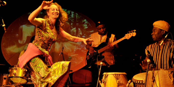 Performing group on stage with dancer at forefront